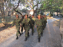 July 7, 2015 - BALULE RESERVE, SOUTH AFRICA: A foot patrol. LED BY BRITISH former military personnel these pictures show how courageous women anti-poachers train with guns in their battle to preserve Africa's endangered animals. Operating in the Kruger National Park's Balule Nature Reserve the 24-member strong all-female Black Mamba Anti-Poaching Unit patrols 50,000 hectares of bush to protect elephants and rhinos that are hunted as part of the estimated £12billion a year illegal world animal trade. These ladies, who as pictures show pose with weapons but also know how to party, are on the front line of a deadly war for the resources of their continent. Over the past year 1,000 wildlife rangers have been killed in Africa while protecting endangered wildlife. Black Mamba Commander and former Royal Navy serviceman Russell Baker (28) from Grimsby, UK explained exclusively how and why this South African special unit was established. (Credit Image: © Media Drum World/MediaDrumWorld/ZUMAPRESS.com)