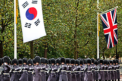 © Licensed to London News Pictures. 05/11/2013. London, United Kingdom. Soldiers march down the Mall during a State Visit to the UK by President of the Republic of Korea, Park Geun-hye. Photo credit : Andrea Baldo/LNP