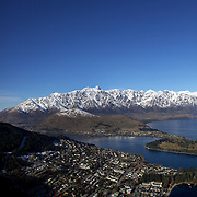 A view of Queenstown, New Zealand with the snow capped Remarkables mountain range providing a stunning backdrop..Queenstown is nestled on the shores of the crystal clear waters of Lake Wakatipu in the Central Otago region of the South Island of New Zealand..Queenstown is New Zealand's premier tourist destination providing an abundance of year round outdoor activities for both young and old. Queenstown, Central Otago, South Island, New Zealand. 17th July 2011. Photo Tim Clayton..