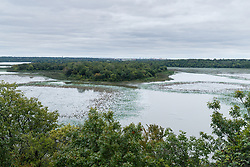 """Greer Island in Lake Worth as seen from Lone Point on the Canyon Ridge Trail, Fort Worth Nature Center, Fort Worth, Texas USA. Greer Island is the home of the famed Lake Worth Monster, or """"Goatman""""."""
