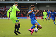 AFC Wimbledon striker Lyle Taylor (33) tackling Peterborough United defender Michael Smith (2) during the EFL Sky Bet League 1 match between AFC Wimbledon and Peterborough United at the Cherry Red Records Stadium, Kingston, England on 17 April 2017. Photo by Matthew Redman.