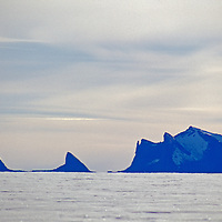 Lonely mountains poke through a mile-thick glacier in Queen Maud Land.