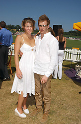 AMBER NUTTALL and TOM AIKENS at the Veuve Clicquot sponsored Gold Cup Final or the British Open Polo Championship held at Cowdray Park, West Sussex on 17th July 2005.<br /><br />NON EXCLUSIVE - WORLD RIGHTS