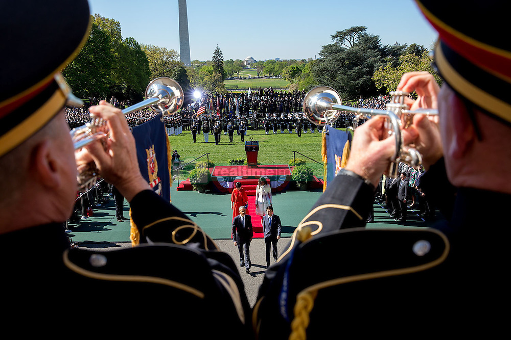 President Barack Obama, First Lady Michelle Obama, Prime Minister Shinzo Abe of Japan and First Lady Akie Abe depart the State Arrival ceremony on the South Lawn of the White House, April 28, 2015. (Official White House Photo by David Lienemann)<br /> <br /> This official White House photograph is being made available only for publication by news organizations and/or for personal use printing by the subject(s) of the photograph. The photograph may not be manipulated in any way and may not be used in commercial or political materials, advertisements, emails, products, promotions that in any way suggests approval or endorsement of the President, the First Family, or the White House.