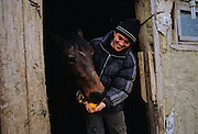 """Cleja village, Klésza in Hungarian, Marius is the son of a csango leader, Andai Duma. Marius here is with his horse of Asian breed, witness of the roots of the Csango, the """"Sons of the Wind"""" . Many Hungarian historians believed that the Csango people were the descendants of the Huns, but that is no longer the scholarly consensus."""