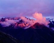 Sunset light illuminating breaking storm clouds over Castle Rocks, Sequoia National Park, California.