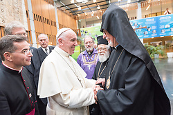 """21 June 2018, Geneva, Switzerland: At the end of an Ecumenical Encounter between Pope Francis and the World Council of Churches, Pope Francis is greeted by His Eminence Archbishop Dr Vicken Aykazian (WCC central committee member). On 21 June 2018, the World Council of Churches receives a visit from Pope Francis of the Roman Catholic Church. Held under the theme of """"Ecumenical Pilgrimage - Walking, Praying and Working Together"""", the landmark visit is a centrepiece of the ecumenical commemoration of the WCC's 70th anniversary. The visit is only the third by a pope, and the first time that such an occasion was dedicated to visiting the WCC."""