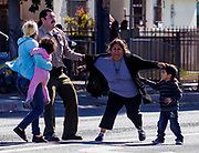 A Los Angeles County sheriff officer tries to stop the family members of the suspect running cross the tape line after   a suspected car burglar was wheeled out of a market on a gurney on Wednesday November 6, 2013 in Los Angeles, California. A suspected car burglar who apparently broke into a Florence-area market through a skylight hid from sheriff's deputies for several hours today until law enforcement officers went in to get him.