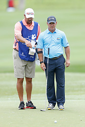 June 22, 2018 - Madison, WI, U.S. - MADISON, WI - JUNE 22:  Scott McCarron confers with his caddy on the ninth green during the American Family Insurance Championship Champions Tour golf tournament on June 22, 2018 at University Ridge Golf Course in Madison, WI. (Photo by Lawrence Iles/Icon Sportswire) (Credit Image: © Lawrence Iles/Icon SMI via ZUMA Press)