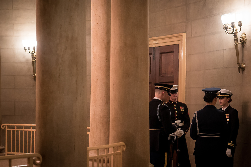 A military honor guard prepares to watch over the casket of Former President George H.W. Bush as it lies in state at the U.S. Capitol on Dec. 3, 2018.