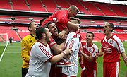 North Shields Manager Graham Fenton being lifted during the FA Vase Final between Glossop North End and North Shields at Wembley Stadium, London, England on 9 May 2015. Photo by Phil Duncan.