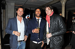 Left to right, TRISTAN HOARE, TOM CARR and HUGO HEATHCOTE at a party to celebrate the launch of the new Vertu Constellation phone - the luxury phonemakers first touchscreen handset, held at the Farmiloe Building, St.John Street, Clarkenwell, London on 24th November 2011.