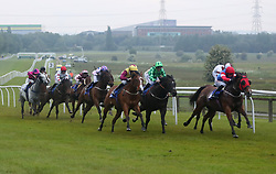 Runners and riders round the final bend during The Constant Security Services Handicap Stakes at Pontefract Racecourse.