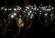 People hold up photos of assassinated anti-corruption journalist Daphne Caruana Galizia and torches on mobile phones during a vigil to mark eleven months since her murder in a car bomb, in Valletta, Malta September 16, 2018.  REUTERS/Darrin Zammit Lupi      TPX IMAGES OF THE DAY - RC163CC316A0