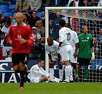 Photo. Jed Wee.Digialsport<br /> Bolton Wanderers v Manchester United, Barclays Premiership, 11/09/2004.<br /> Bolton players are shell-shocked at they concede late in injury time.
