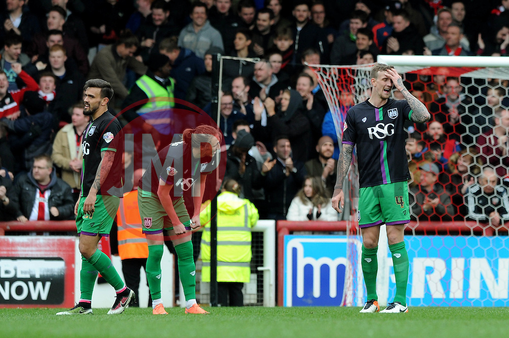 Aden Flint of Bristol City (right) cuts a dejected figure as Brentford equalise late in the game - Mandatory by-line: Dougie Allward/JMP - 16/04/2016 - FOOTBALL - Griffin Park - Brentford, England - Brentford v Bristol City - Sky Bet Championship