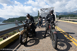 Ricky Bartels and Jon Dobbs pull out some cash to pay for the Columbia River bridge crossing on the last day of the Motorcycle Cannonball coast to coast vintage run. Stage 15  (51 miles - the Grand Finish) from The Dalles to Stevenson, OR. Sunday September 23, 2018. Photography ©2018 Michael Lichter.