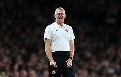 Brentford Manager Dean Smith on the touchline during the Carabao Cup, Third Round match at the Emirates Stadium, London.