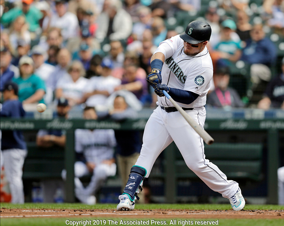 Seattle Mariners' Daniel Vogelbach swings into a pitch from Kansas City Royals starting pitcher Brad Keller for a solo home run during the first inning of a baseball game, Wednesday, June 19, 2019, in Seattle. (AP Photo/John Froschauer)