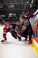 KELOWNA, BC - OCTOBER 12: Athletic therapist Scott Hoyer checks out Trevor Wong #8 of the Kelowna Rockets after he was boarded in front of the bench against the Kamloops Blazers at Prospera Place on October 12, 2019 in Kelowna, Canada. (Photo by Marissa Baecker/Shoot the Breeze)