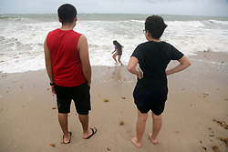 Kamila Canchola, 8, of Fort Lauderdale, FL, USA., plays in the surf as her brother, German Sanchez, 21, and sister, Abigail Sanchez, 16, watch on Fort Lauderdale Beach as Hurricane Irma pushes into South Florida on Saturday, September 9, 2017. Photo by Amy Beth Bennett/Sun Sentinel/TNS/ABACAPRESS.COM