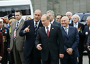 Moscow, Russia, 09/05/2005..Russian President Vladimir Putin, French President Jaques Chirac and Moscow Mayor Yuri Luzhkov unveil a monument to General Charles de Gaulle.
