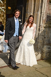 The bride and groom LADY NATASHA RUFUS ISAACS and RUPERT FINCH at the wedding of Lady Natasha Rufus Isaacs to Rupert Finch held at St.John The Baptist Church, Cirencester, Gloucestershire, UK on 8th June 2013.