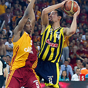 Galatasaray's Jerry JOHNSON (L),and Fenerbahce's Roko Leni UKIC (R) during their Turkish Basketball league Play Off Final fourth leg match Galatasaray between Fenerbahce Ulker at the Abdi Ipekci Arena in Istanbul Turkey on Saturday 11 June 2011. Photo by TURKPIX