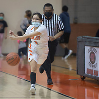 Gallup Bengal Michaela McCurtain (32) drives to the basket as Highland Hornet Delani Crawford (45) defends during their New Mexico Class 4A girls basketball semifinal game at Gallup High School in Gallup Tuesday.