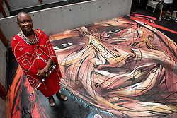 November 10, 2016 - Hong Kong, Hong Kong S.A.R, China - Rooftop painting by Parisian street artist Alexandre Monteiro aka Hopare of Masai warrior Daniel Ole Sambu (Pictured).Street art in Hong Kong ahead of the The √íHope for Wildlife√ì Gala Dinner painted to raise awareness for the plight of endangered animals the world over..Sheung Wan Hong Kong.10th November 2016. Photo by Jayne Russell. (Credit Image: © Jayne Russell via ZUMA Wire)