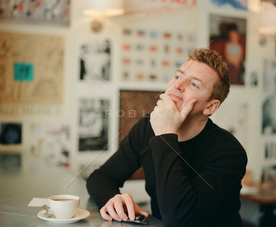 portrait of a man in deep thought at a cafe in New York City