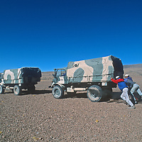 Members of an archaeology expedition push an Argentine Umigog truck below Volcan Llullaillaco on the vast Altiplano of northern Argentina.