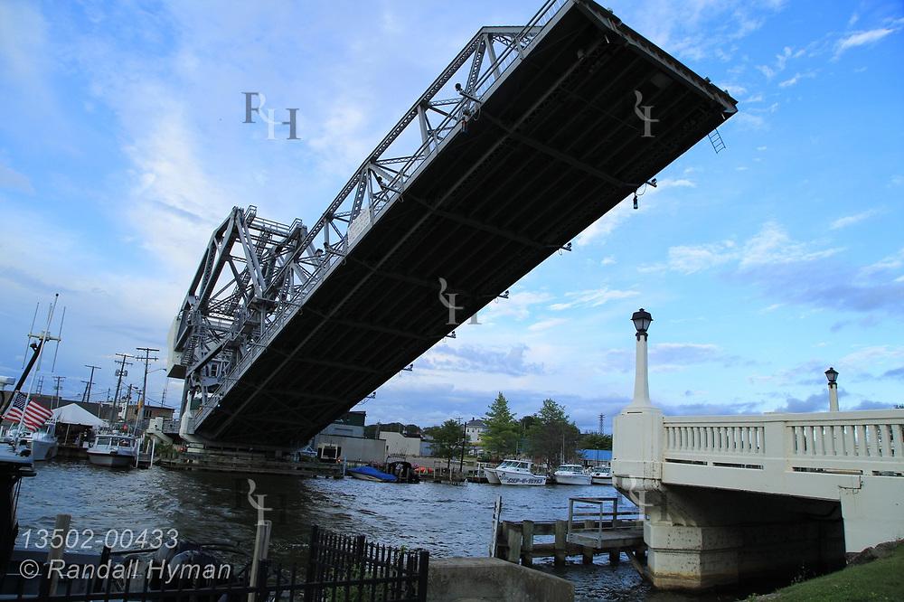 Draw bridge lifts skyward at mouth of Ashtabula River in downtown Ashtabula, Ohio.