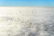 Nederland, Flevoland, Lelystad, 11-12-2013; windmolens steken boven de mist en wolken uit. Zuidelijk Fleovloand, tussen Vogelweg en Gooiseweg (ten ZO Almere)<br /> Wind turbines rise above the fog and clouds. New Polder Flevoland.<br /> luchtfoto (toeslag op standaard tarieven);<br /> aerial photo (additional fee required);<br /> copyright foto/photo Siebe Swart.
