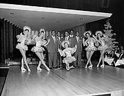 """Ackroyd 04846-8. """"Amato's Supper Club. Interiors & sign. Mills Brothers with chorus girls. December 4, 1953."""" (Amato's was on the SW corner of Broadway & Main)"""