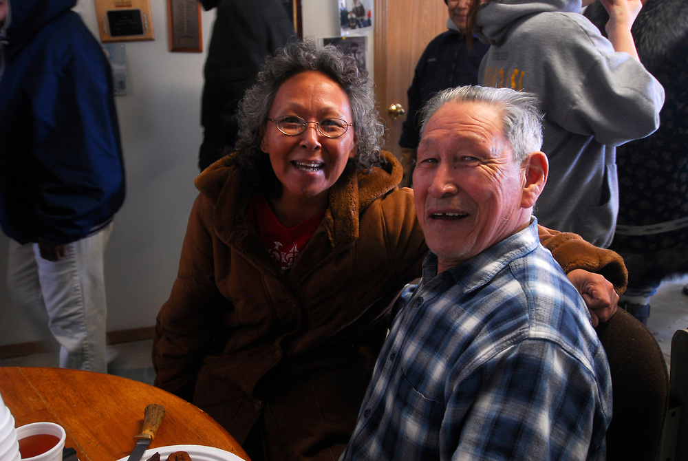 """Barrow, Alaska. After David Leavitt's Crew got a 34ft7"""" whale, the crew serves on the feast at the captain's house. This whale was the fourth landed whale of this Spring season. In the photo is Fannie Akppik and David Leavitt. May 2nd 2007."""