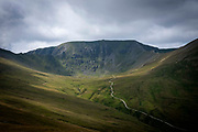 Looking towards the summit of Helvellyn mountain in The Lake District, Cumbria, United Kingdom on the 2nd of August 2021. Helvellyn is the third-highest point in England and is located in the beautiful Lake District National Park and part of the Eastern Fells.