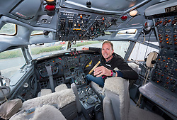 © Licensed to London News Pictures; 10/09/2021; Bristol, UK. PYTCH founder JOHNNY PALMER in the cockpit of the PYTCHAir plane which is open to visitors this weekend as part of Bristol Open Doors festival. PYTCHAir is a converted Boeing 727 installed as extra office pace at the PYTCH company. This year the city-wide Open Doors festival is offering the chance to explore the city with over 60 specially curated experiences looking into places and spaces in Bristol. Photo credit: Simon Chapman/LNP.