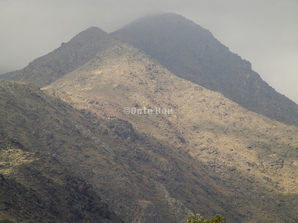 A view of a mountain top in fog.
