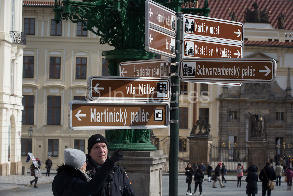 Tourists look for the right direction in Hradcanske Namesti Square, on 19th March, 2018, in Prague, the Czech Republic.