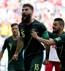 June 21, 2018 - Samara, Russia - MILE JEDINAK (C) of Australia celebrates scoring during the 2018 FIFA World Cup Group C match between Denmark and Australia in Samara, Russia. The two teams played to a 1:1 draw. (Credit Image: © Fei Maohua/Xinhua via ZUMA Wire)