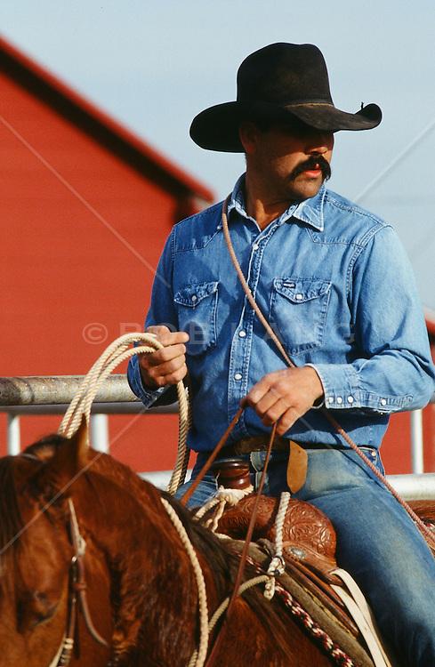 rugged cowboy on a horse