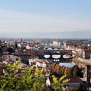 FLORENCE, ITALY - NOVEMBER 01: A panoramic view of Florence showing The Ponte Vecchio (Old Bridge) is a medieval bridge spanning the river Arno in Florence. It is one of the few remaining bridges with houses built upon. The Vasari corridor that runs over the houses connects the Uffizi with the Pitti Palace on the other side of the river. Florence, Italy, 1st November 2017. Photo by Tim Clayton/Corbis via Getty Images)