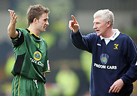 Norwich boss Nigel Worthington explains his tactics to captain Adam Drury during a break in play