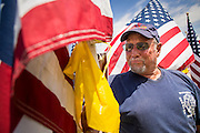 10 SEPTEMBER 2012 - TEMPE, AZ:     JOHN SERIO, a retired Denver, CO, firefighter who worked at Ground Zero after the September 11, 2001, attacks, walks through the Healing Field in Tempe, AZ, Monday. The Exchange Club of Tempe and the city of Tempe are hosting the 9th Annual Healing Field display. The annual event posts three thousand American flags in the Tempe Beach Park. The display is a tribute to those who died in the terrorist attacks of September 11, 2001. Nearly 3,000 people were killed when terrorists affiliated Al-Qaeda crashed commercial airliners into the World Trade Center in New York, the Pentagon in Arlington, VA, and a field in Ohio.   PHOTO BY JACK KURTZ