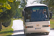 A tourist bus driving through the vineyards in Medoc, Bordeaux