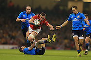 Dan Lydiate of Wales runs  over Italy's Guglielmo Palazzani. RBS Six Nations championship 2016, Wales v Italy at the Principality Stadium in Cardiff, South Wales on Saturday 19th March 2016. pic by  Andrew Orchard, Andrew Orchard sports photography.