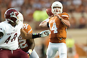 AUSTIN, TX - AUGUST 31: David Ash #14 of the Texas Longhorns drops back to pass against the New Mexico State Aggies on August 31, 2013 at Darrell K Royal-Texas Memorial Stadium in Austin, Texas.  (Photo by Cooper Neill/Getty Images) *** Local Caption *** David Ash