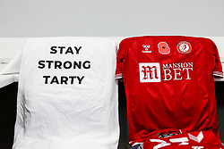 """Bristol City warm up shirts reading """"Stay Strong Tarty"""" in the dressing room, to show support for popular club equipment manager Phil Tart who is currently unwell - Rogan/JMP - 06/11/2020 - Cardiff City Stadium - Cardiff, Wales - Cardiff City v Bristol City - Sky Bet Championship."""