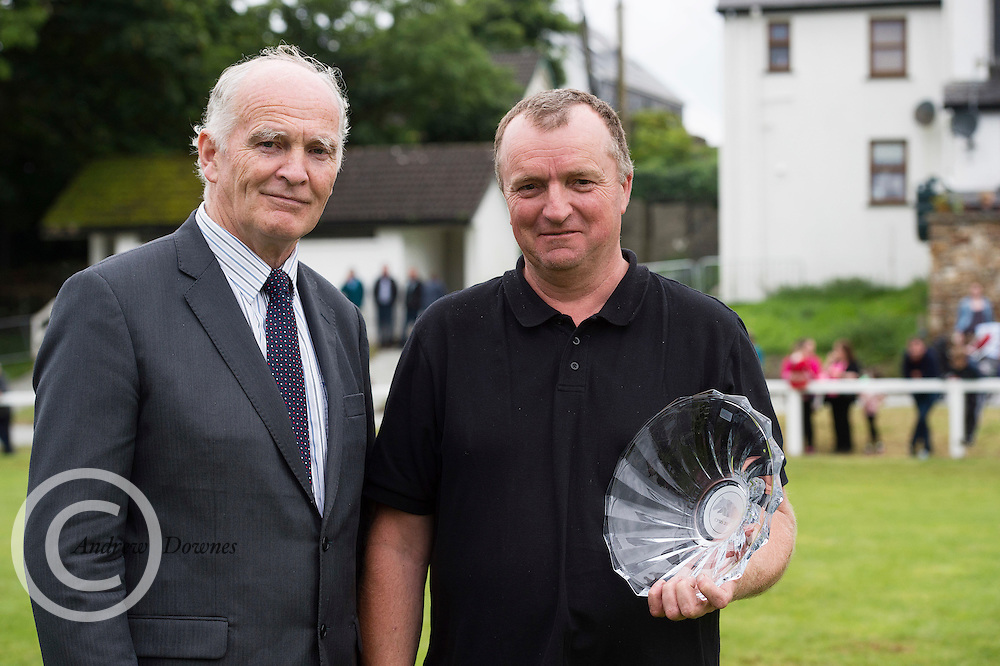 Tom Mac Lochlainn President Connemara Pony Breeders Society with Henry Whyte who was presented with galway Crystal  for thirty years volunteering on show committee at the 93rd annual Connemara Pony show in Clifden Co. Galway  Photo:Andrew Downes, XPOSURE